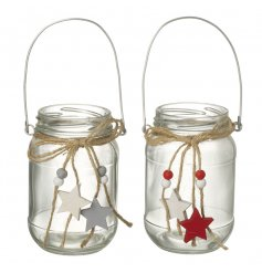 An assortment of 2 jam jar lanterns with decorative ties