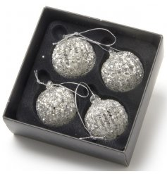 A set of 4 glass glitter baubles with spun glass.