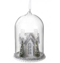 A vintage inspired hanging decoration with a winter scene house and a touch of festive tinsel.