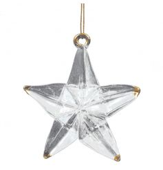 A glass star decoration with gold tips.