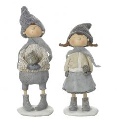 A mix of 2 charming boy and girl standing ornaments each with winter outfits.