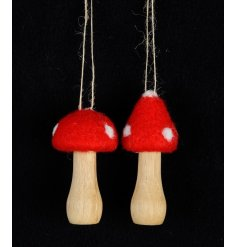 An assortment of 2 enchanting wooden and felt toadstool ornaments with hangers.
