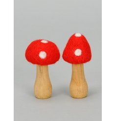 A mix of 2 enchanting toadstool ornaments made from wood and felt. Other sizes are also available.