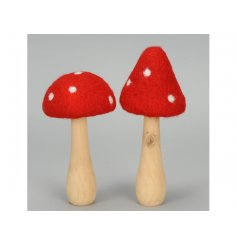 Add a little magic to the home with this assortment of 2 wooden and felt toadstool ornaments.