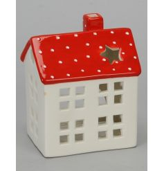 A nordic style red and white ceramic t-light house with a polka dot roof and star shaped window.