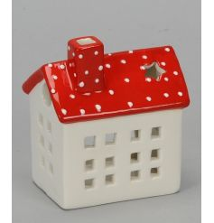 A charming ceramic t-light house with a red polka dot roof and star window.