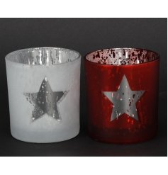 A mix of two red and white nordic inspired t-light holders with a star design.