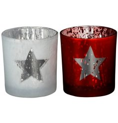 A mix of two red and white t-light holders with a star design.
