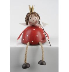 A charming red polka dot angel shelf sitter. Complete with a crown and star shaped wand.
