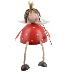 An adorable red and white polkadot angel shelf sitter with crown and wand.
