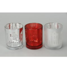 A mix of 3 great value glass t-light holders, each with a nordic house design.