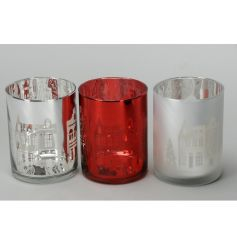 A mix of 3 nordic inspired glass t-light holders with a traditional festive house scene.