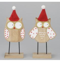 A mix of 2 adorable wooden owl ornaments with fabric Christmas hats.