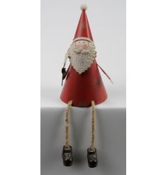 A charming metal Santa shelf sitting ornament.