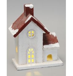 A woodland inspired wooden house ornament with a copper coloured roof and LED lights.