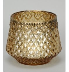 A stunning decorative t-light holder with an ornate antique style rim.