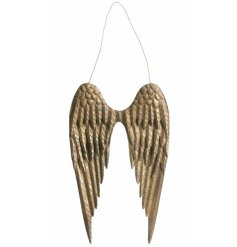 A beautiful pair of metal angel wings with a gold antique finish.