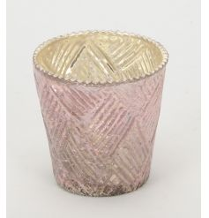 A decorative glass t-light holder with a pearlised pink finish.