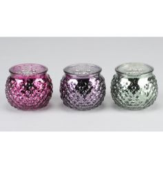An assortment of 3 luxury glass t-light holders in rich purple, pink and green colours. Each has a textured finish.