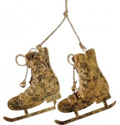 A charming pair of metal skates with jute string laces, complete with bells. With an antique gold finish.