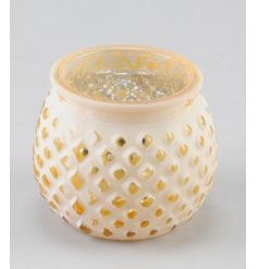 An elegant glass t-light holder with a decorative pattern and a gold and white finish.