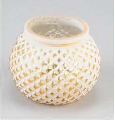 A chic white and gold patterned t-light holder.