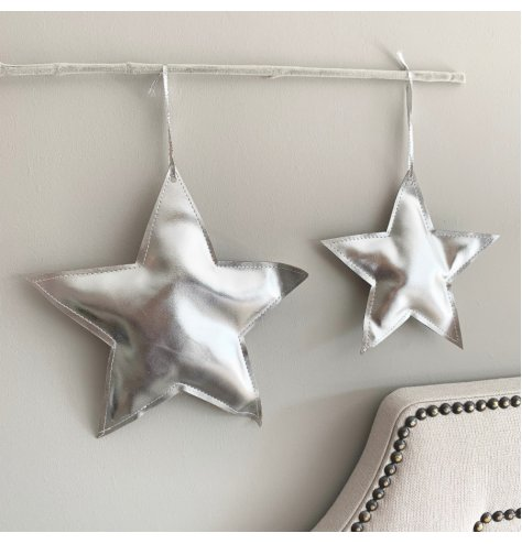 A stunning silver star decoration with shimmering fabric and a silver hanger.