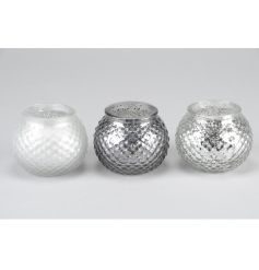 An assortment of 3 silver and white textured t-light holders in chic metallic colours.