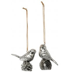 An assortment of two antique silver hanging bird ornaments with pinecones.