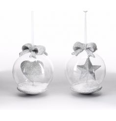 An assortment of 2 clear baubles, filled with artificial snow, a glitter ornament and topped with a decorative bow.