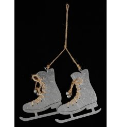 A pair of silver metal hanging skates with jute string laces and silver bells. A unique tree ornament.