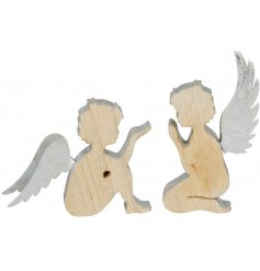 A mix of two wooden angel ornaments with a painted edge and silver metal wings.