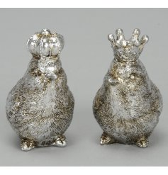 A mix of two antique inspired bird ornaments with crown. A unique decorative item for the home.
