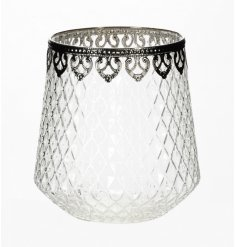 A large glass t-light holder with an antique silver finish. A beautiful decorative accessory for the home.