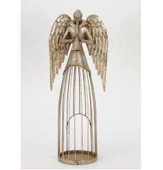 A unique antique gold angel with trumpet decoration with a t-light holder caged within her skirt.