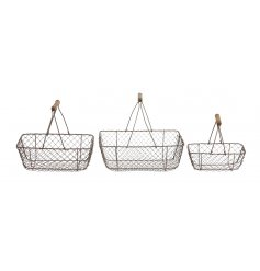 A set of 3 country living style metal baskets with wooden handles.