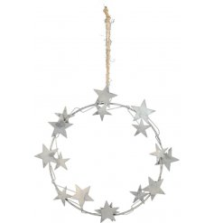 A stylish silver metal wreath made from various sized stars. A simple and unique festive decoration.