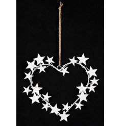 This stylish hanging heart with metal star accents will be a twinkling accessory in any room