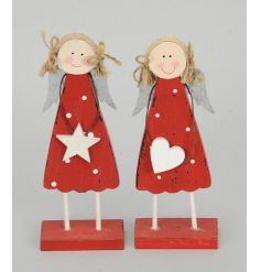Two sweet standing wooden angels, stood on red blocks.