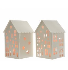 An assortment of 2 white metal house decorations with LEDs inside