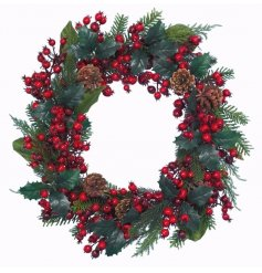This beautiful berry infused wreath will be sure to hang perfectly amongst any door at christmas