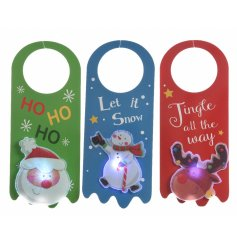 An assortment of 3 LED light up Christmas door hangers