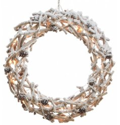 Large wall hanging rattan wreath with snow and pinecones