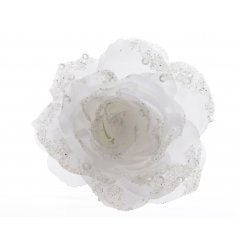 A beautiful artificial rose with added glitter details, clip onto any home piece for that sweet floral feel