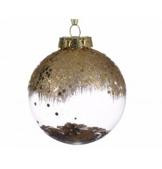 A stylish clear shatterproof bauble topped in a fall effect gold glitter. Filled with free flowing gold flowers for tha