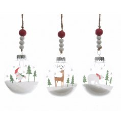 An assortment of 3 clear Christmas Scene Baubles With Wooden Bead hangers