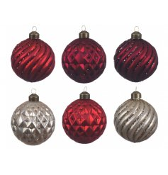An assortment of 12 red, oxblood and pearl glittery baubles.