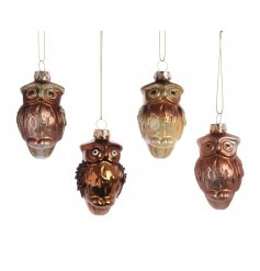 An assortment of 4 gold and copper owl hanging decoration