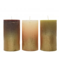 An assortment of 3 small metallic dipped wax pillar candles
