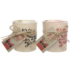 An assortment of 2 scented candles in glass with jute wrap